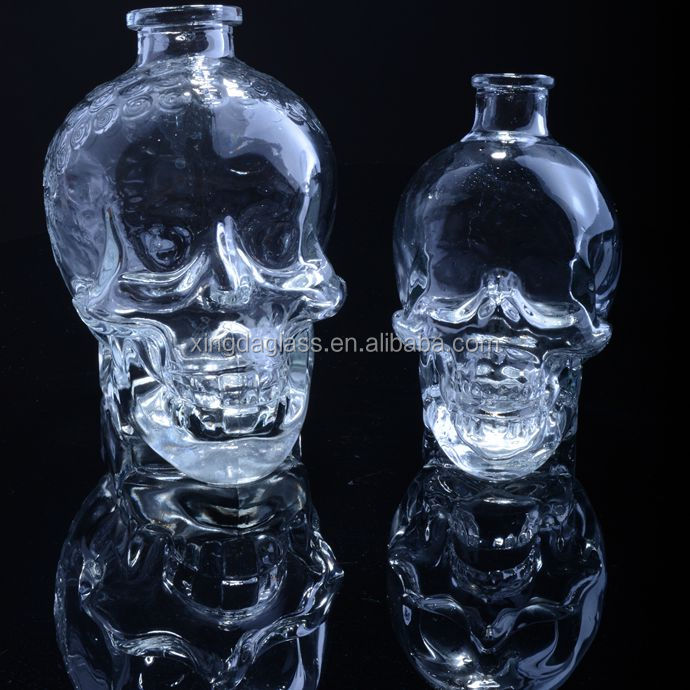 export hot sell fashion packing crystal head vodka glass bottle