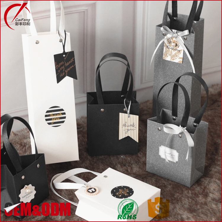 High quantity custom chrismas gift package paper bags with handle