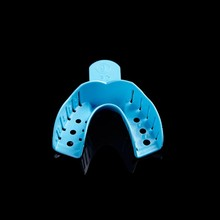 Disposable perforated impression edentulous trays