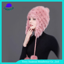 Hign quality 100% winter warm knitted hats fashionable women pompom beanie hat ear flap wholesale