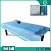 blue medical examination table disposable bed sheet