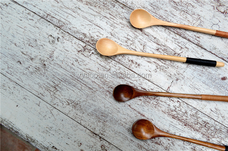 The wooden long straight handle coffee stirs the wooden honey spoon