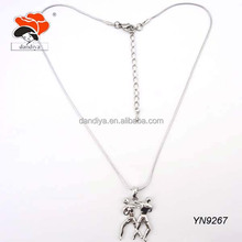 Two people play basketball style necklace