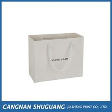 Top fashion logo printed promotional cheap paper shopping bags