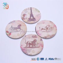 Vintage handcrafted round ceramic wine bottle coaster cup with horse Eiffel Tower design