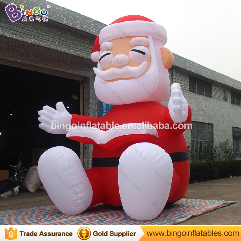 Reading book inflatable christmas old man with stocking for decor
