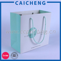 Luxury customized printed blue paper gift bag with rope handle