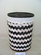 round white and black slat wood chip laundry hamper with inner bag