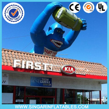 Commercial advertising inflatable decoration giant gorilla grabbing car on building