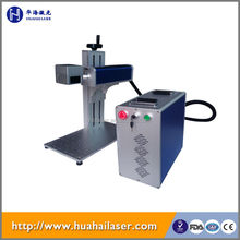 Huahai fiber laser Small character logo label letter series number fiber laser printing machine for sale with Trade Assurance