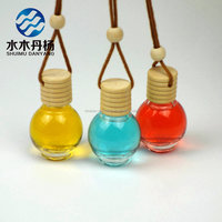 Fancy 10ml round shaped car hanging air freshener perfume glass bottle wholesale