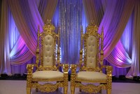 silver frame white fabric bride and groom wedding chairs