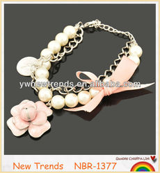 2014 popular beaded pearl bracelets with flower pendant and ribbon bow