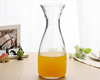 Haonai High Quality Transparent Milk Glass bottle , Wholesale Ice Orange Glass bottle