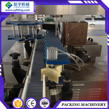 Semi-automatic wet glue labeling machine for plastic bottles