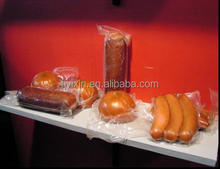 Multilayer compound co-extruded sausage casing