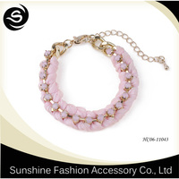 Fashion jewelry bracelets made of pink ribbon and gold plated thick chain with diamond
