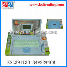 kid studying english computer toy