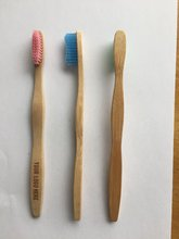 Charcoal bristle bamboo toothbrush with wooden handle