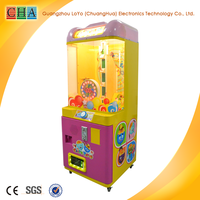 Toy vending machine, toy catching game, toy prizing machine Candy Dispenser with bill accepter
