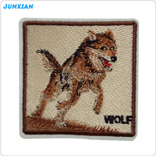 Factory price custom embroidered wolf design animal shape patch