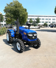 small agricultural equipment farm tractor with front end loader