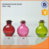round shaped glass perfume bottle with cork
