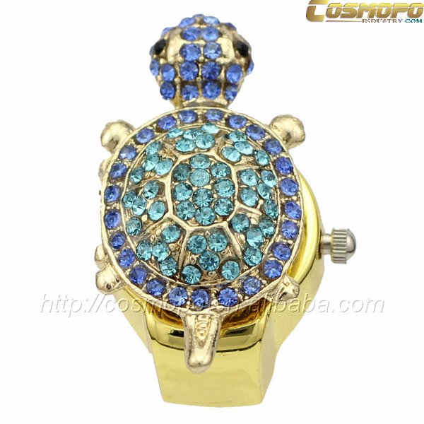 tortoise case with blue stones gold plating ring watch