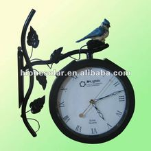 metal solar powered outdoor wall mounted clock bird