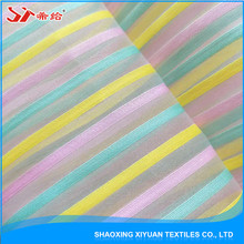 Wholesale cheap 100% polyester rainbow stripe organza fabric for dresses