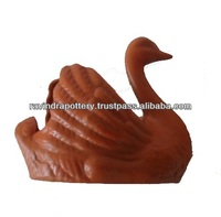 Swan shaped red clay wedding cake box