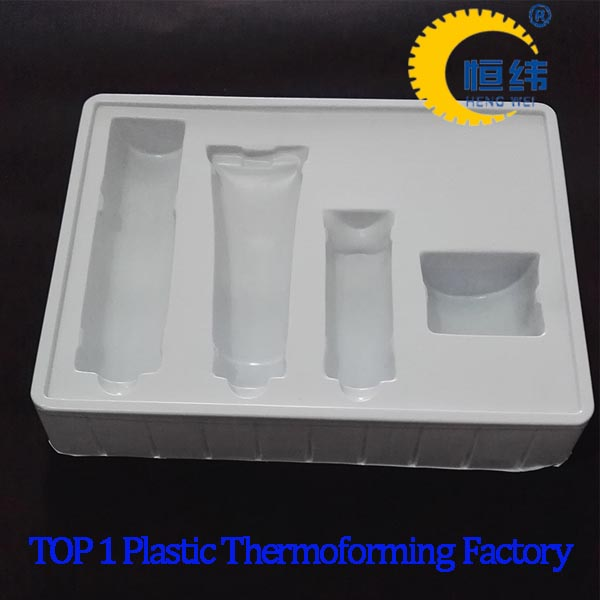 plastic tray with dividers for cosmetic packaging blister