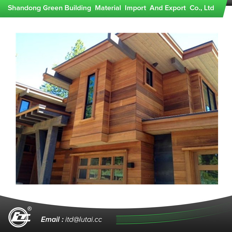 Decorative wood grain siding panel for steel house