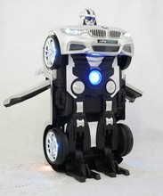 2017 Newest kids electric toy car to drive with distortion robot function