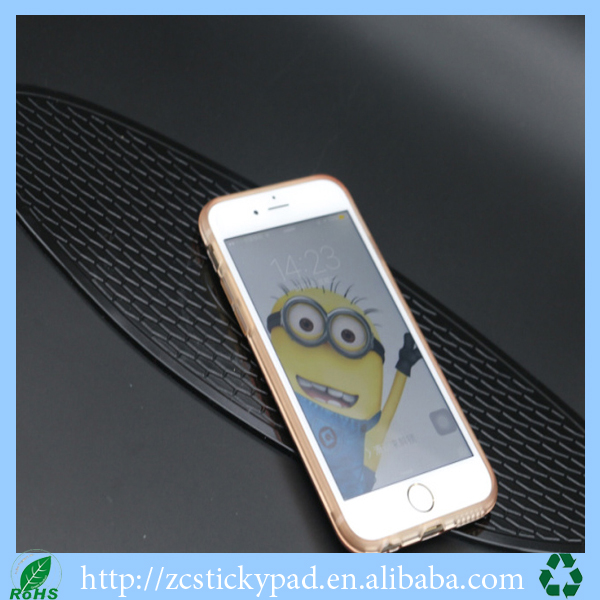 Sticky nano dash pad for your mobile phone on the car dashboard
