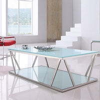 Glass top stainless steel base on coffee table