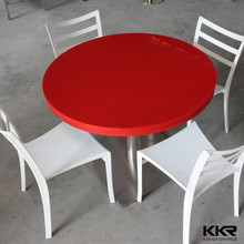 Solid surface red hideaway dining table and chair set