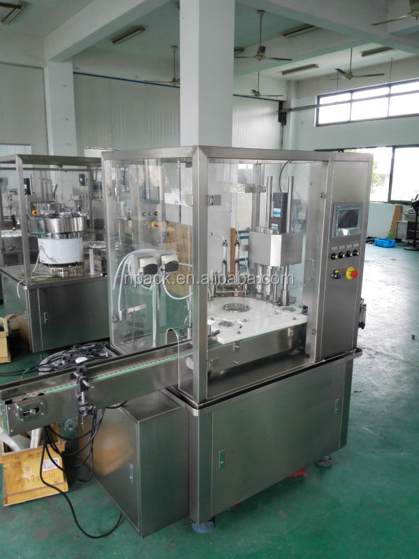 Automatic vial liquid filling stoppering and capping machine