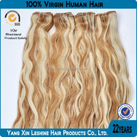 Wholesale 6 7 8 pieces tangle free remy curly blonde clip in hair extensions
