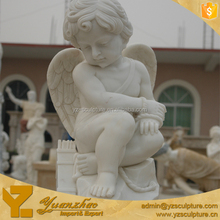 life size carved stone sitting cherub angel sculpture