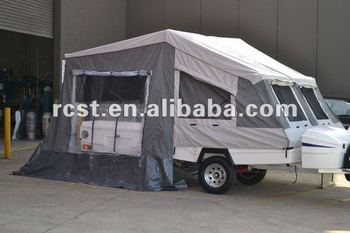 Highlighted fiberglass camper trailer with popular canvas tents