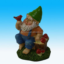 Small polyresin gnome figurine with red bird basket
