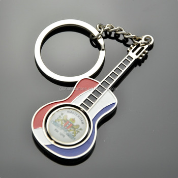 Holland souvenir guitar key chain with spinning round logo
