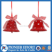 red metal christmas bell with ribbon bow hanging tree ornaments dot star pattern