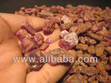 Reddish fine quality Ruby rough, with sparkling translucent hue