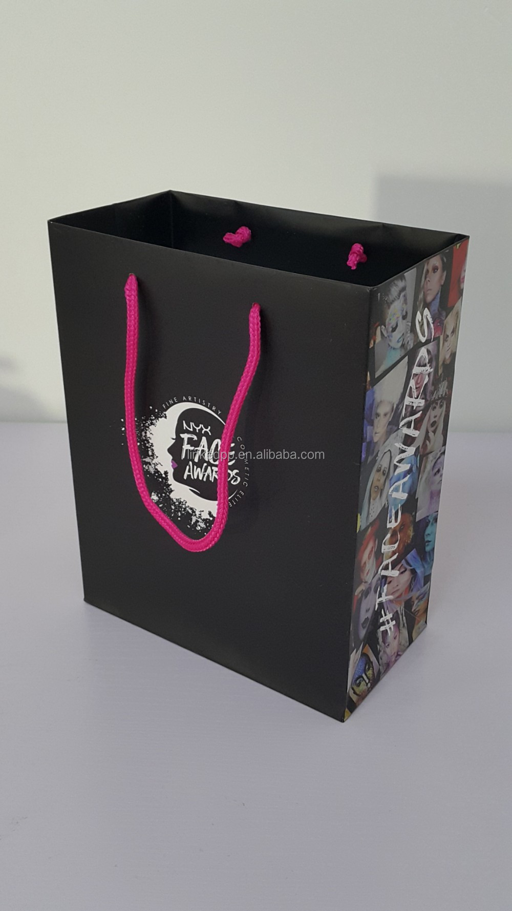 Famous brand paper gift bag with pink rope handle