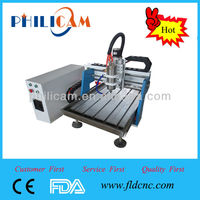 China mini cnc router 6090 with rotary attachment and high precision