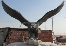 flying eagle statues on stones