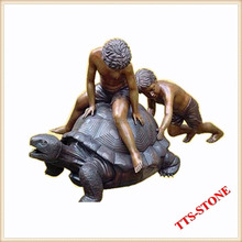 Bronze boy statues sitting on tortoise sculpture