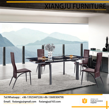Modern metal tempered glass extendable dining table with 6 chairs